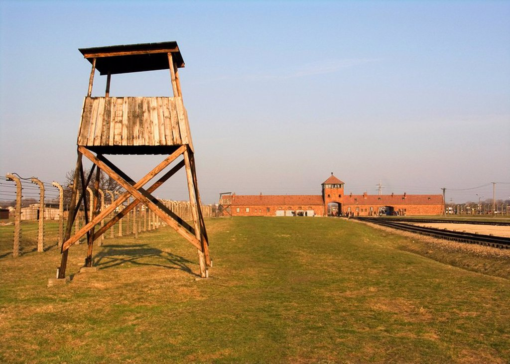 Poland, concentration-camps, Auschwitz-II, Auschwitz-Birkenau, extermination camps, KZ-Gelände, main-entrance, tracks, Oswiecim, Brzezinka, KZ, buildings, main buildings, rails, tracks, gate, camp-gate, tower, gate tower, drive, entrance, watchtower, fenc : Stock Photo