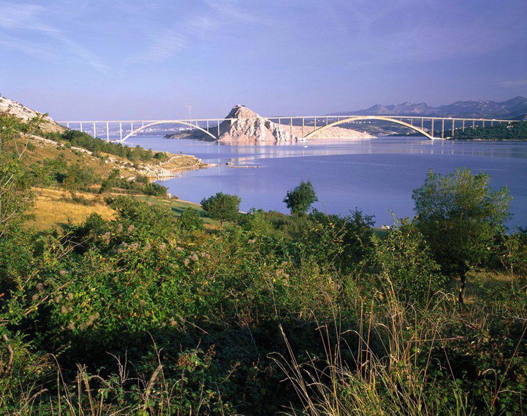 Croatia, Istria, island Krk, bridge Krcki cider Adriatic Sea destination coast_landscape, vegetation, rocks, mountains, view, construction, architecture, bridge_architecture, bows, Krk_bridge, bow_bridge, : Stock Photo