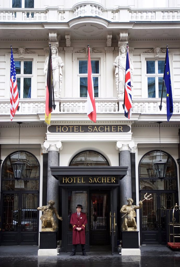 Austria, Vienna, Kärntner Street, hotel Sacher, entrance_area, porter, capital, hotel_buildings, tradition_hotel, famous, universally known, entrance, people, man, hotel_employee, stands, waits, work, occupation, sightseeing, sight, symbol, Hotellerie, tr : Stock Photo