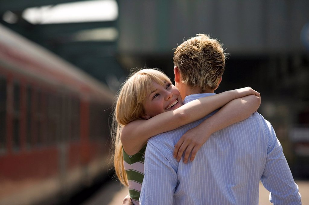 Platform, couple, greedsing, embrace, cheerfully, series, people, love_pair, young, joy, happily, arrives, greedss, welcome, sees again, return, arrival, love, affection, tenderness, enjoyment of reunion, railway station, train, track_trip, trip, business : Stock Photo