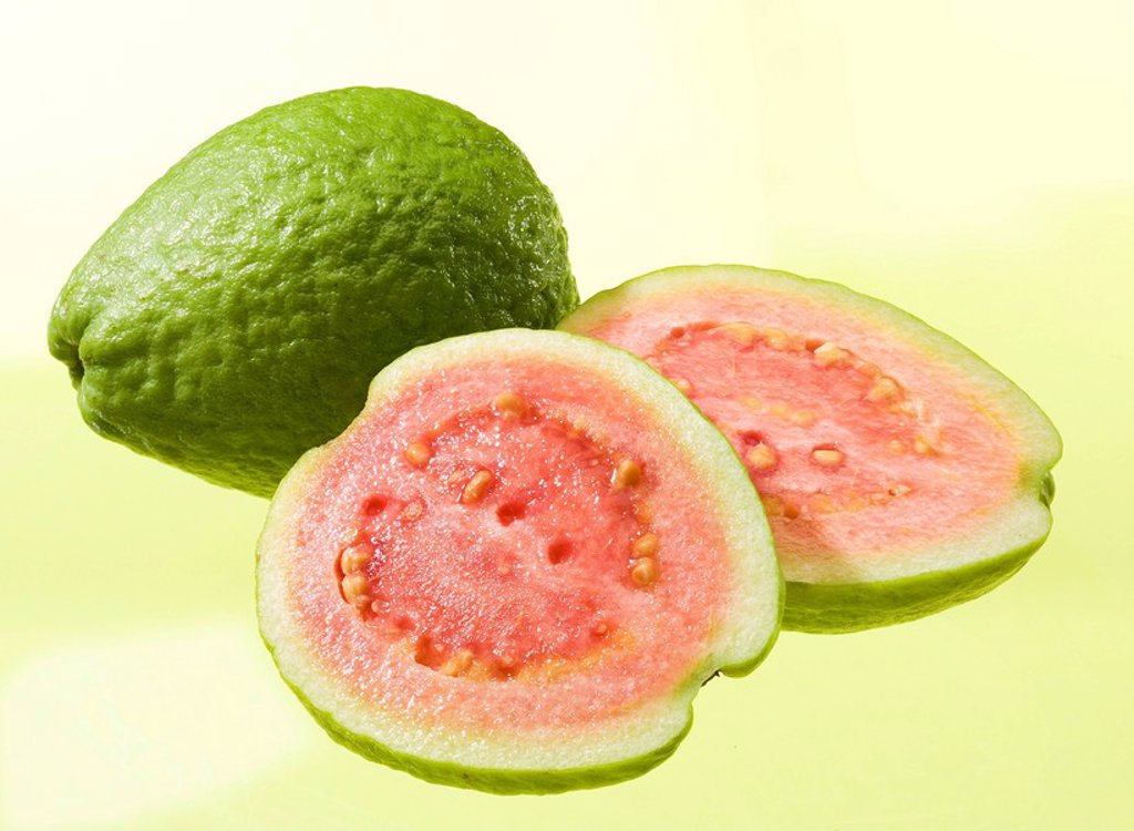 Guaven, completely, myrtle_plants, cut open fruit, fruits guava Guava Guayaba Goiaba, tropical, exotic, juicy, fruity, aromatic, sweet_acid, salmon_colored, unripe, vitamin_rich, studio, : Stock Photo