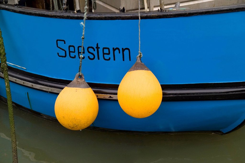 Germany, East Frisia, northern dike, harbor, fisher_boat, detail, fenders, : Stock Photo