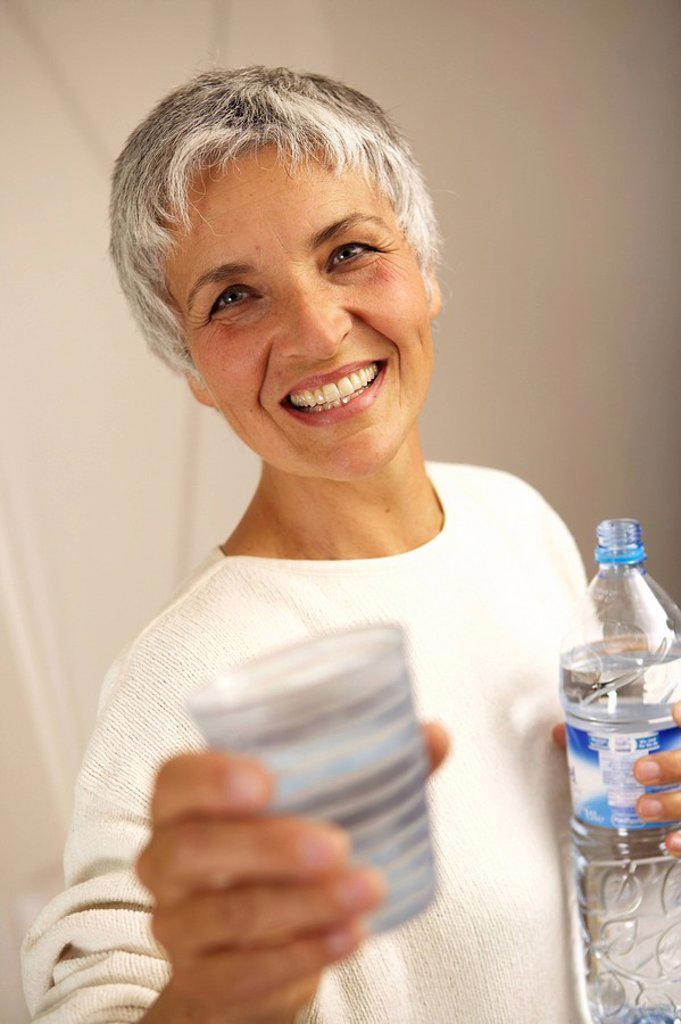 Stock Photo: 1558-154021 Senior, smiles, tumbler, holding, portrait, model released,