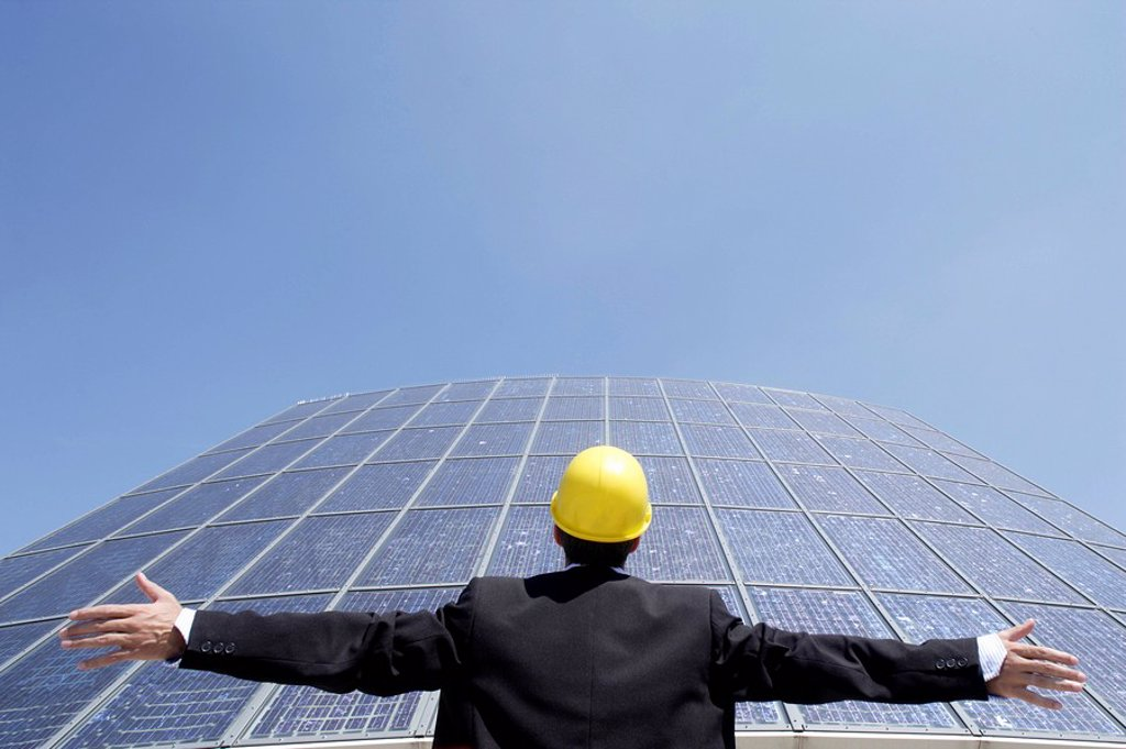 Architect, hard hat, solar cells, standing, gesture, portrait, back view, outside, : Stock Photo