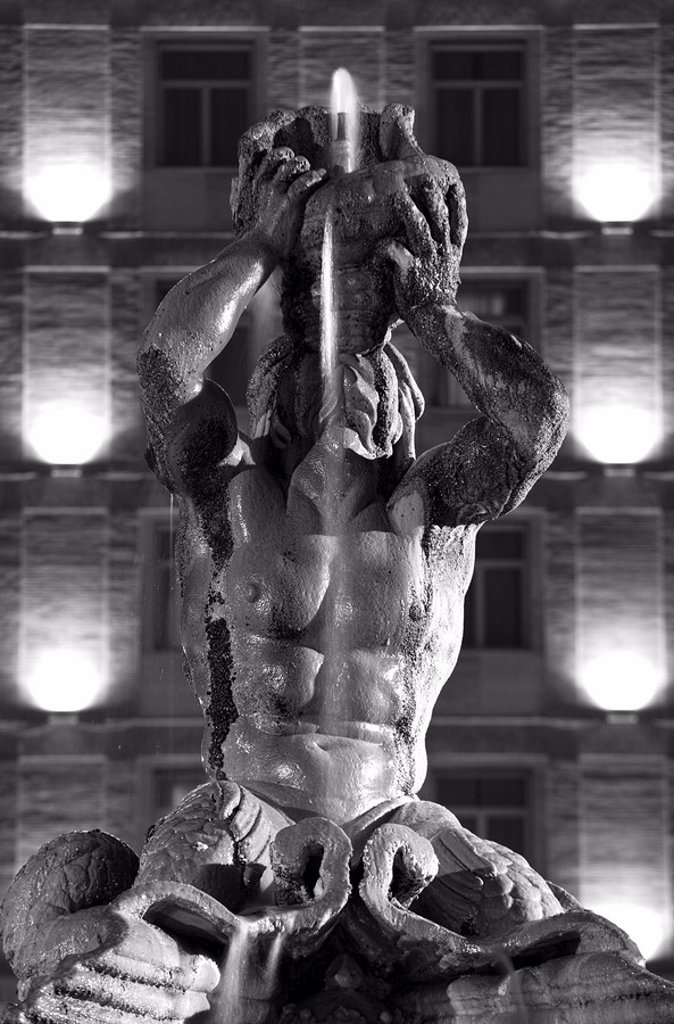 Italy, Rome, fountain, Fontana del Tritone, fountain figure, sea God, detail, lighting, night, s/w, : Stock Photo