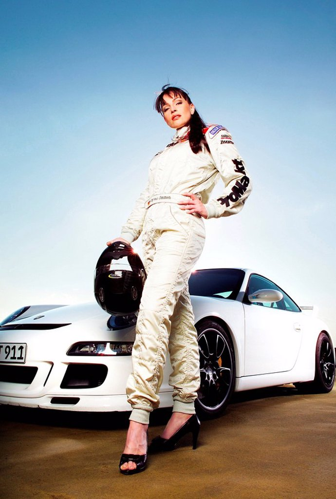 Woman, racing suit, helmet, stilettos, sports_car, : Stock Photo
