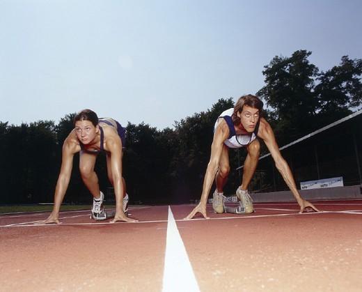 Tartan track, runner, start position : Stock Photo