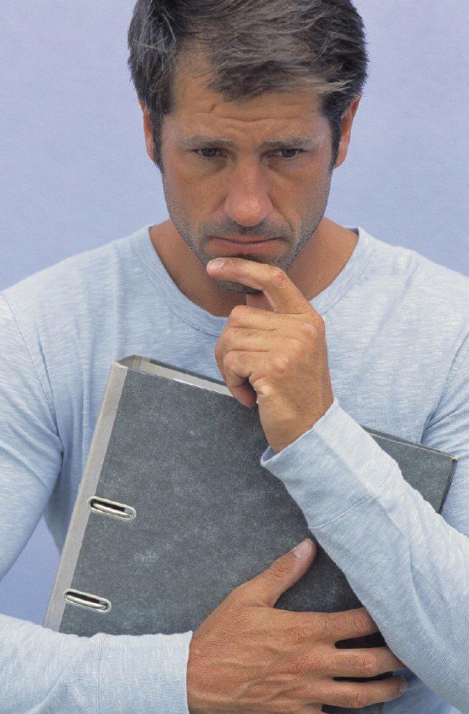 Man, thoughtful, file folder : Stock Photo