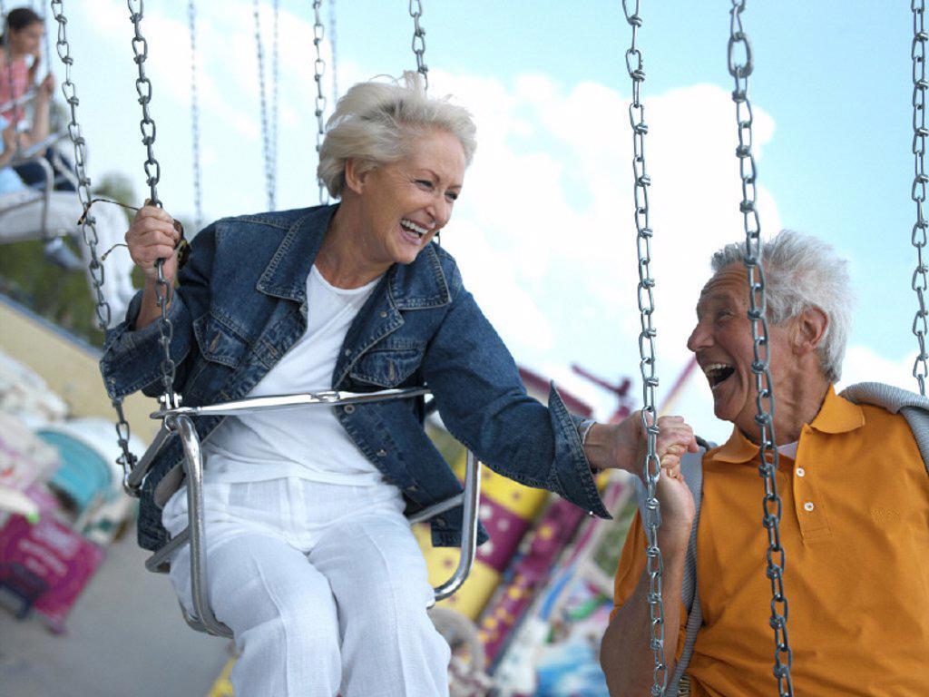 Spring festival, merry-go-round, senior pair : Stock Photo