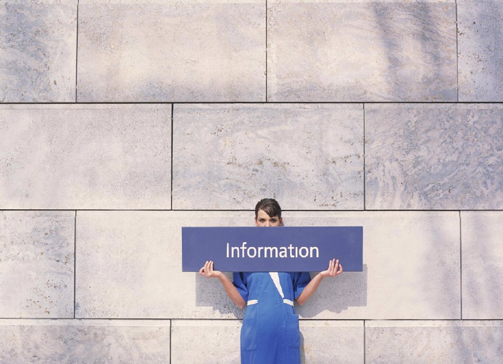 Stock Photo: 1558-53612 Woman, work frocks, sign