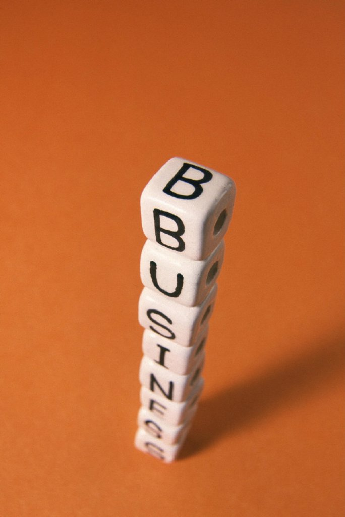 Stock Photo: 1558-54098 Dice, stacked, letters