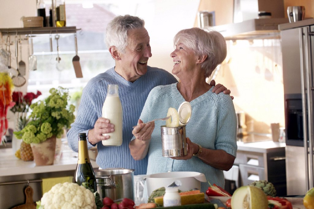 Kitchen, senior pair, cooks : Stock Photo