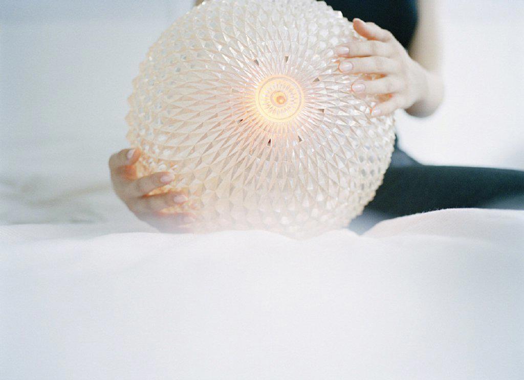 Woman, light ball, detail, ball : Stock Photo