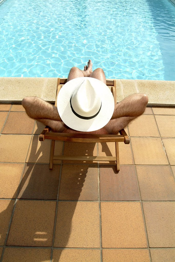 Stock Photo: 1558-59275 Pool edge, deck chair, man, hat,,  relaxen, back opinion  Series, Swimmingpool, pool, basin edge, water, recuperation, relaxation, rests, sunbathes, sunbathes, sunbath, enjoys, poor, crosses, headgear, straw hat, sun protection, vacation, leisure time, su