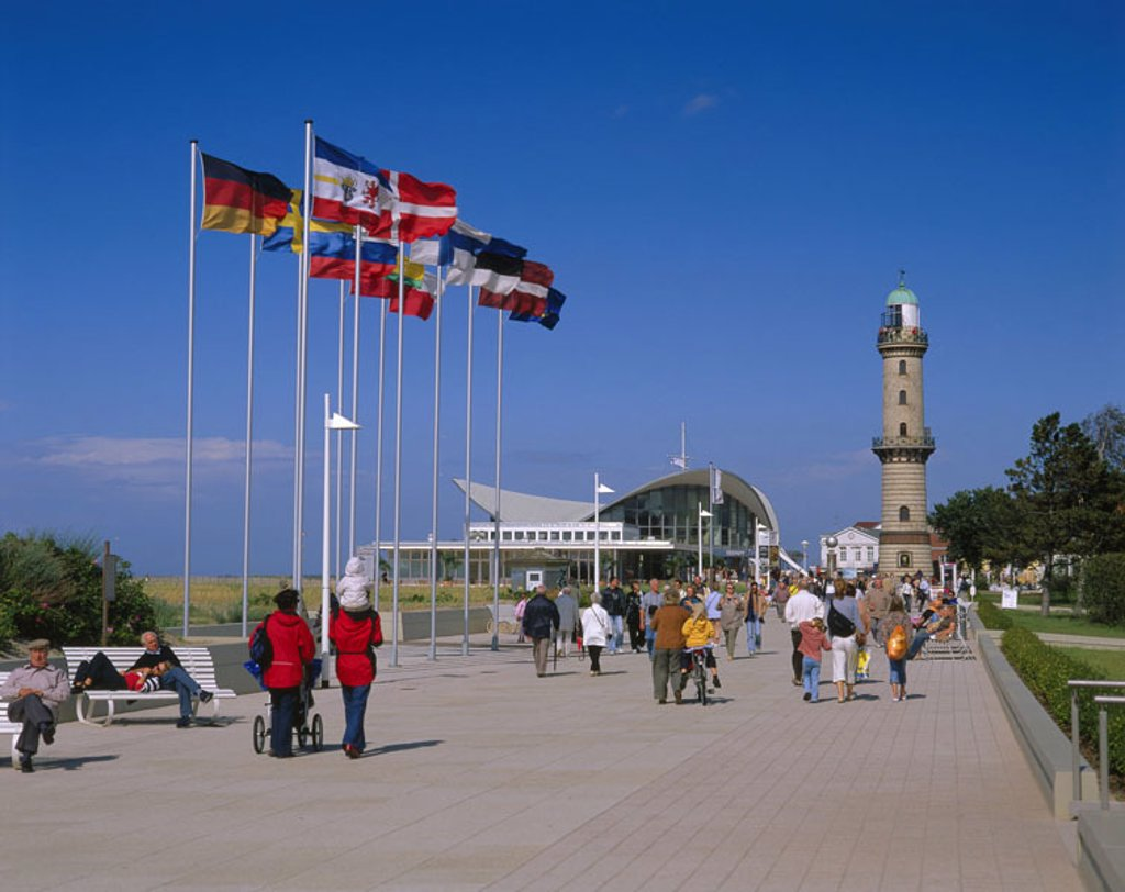 Germany, Mecklenburg-Western Pomerania,  Warnemünde, promenade, passer-bys,  Old lighthouse Europe, Central Europe, north-east Germany, Hanseatic town Rostock, district, boardwalk, tourists, pedestrians, tourism, flagpoles, flagpoles, flags, blows flags, : Stock Photo