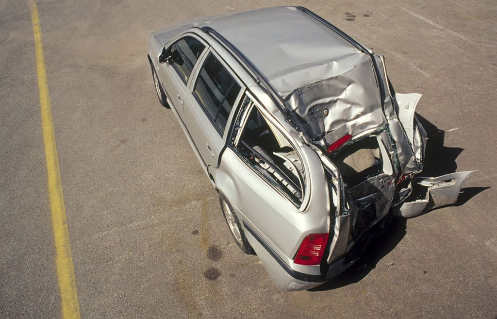 Accident car, stern damage, from above   Accident, traffic, road accident, car accident, Skoda, Oktavia, car, ambulances, private car, silver-colored, sheet metal damage, damage, stern, broken, damages, pressed in, total loss, damage, perspectives : Stock Photo