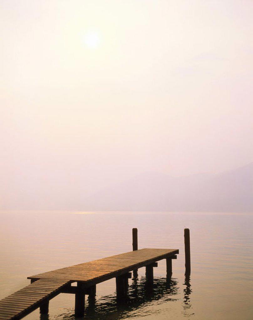 Stock Photo: 1558-61886 Sea, wood bridge, hazy, twilight   Zealand shaft, landscape, bridge, water, water surface, quiet, hazy, dully, concept, silence, silence, nature, idylls, isolation, quiet, dream, idea, wish, freedom, liberating, loneliness, human-empty, leaves