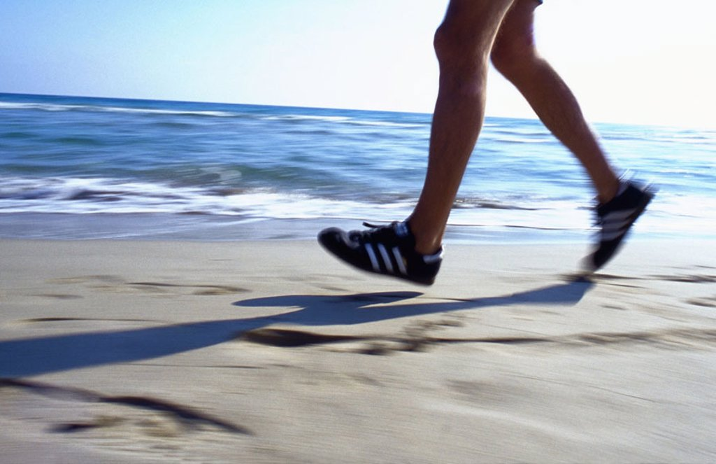 Sandy beach, joggers, detail, legs,    Beach, man, men´s legs, run shoes, gym shoes, Movement, running, jogging, Jogging, run sport, sport, athletically, activity, fitness, health, sandpipers, Training, run training, condition training, vitality,  health- : Stock Photo
