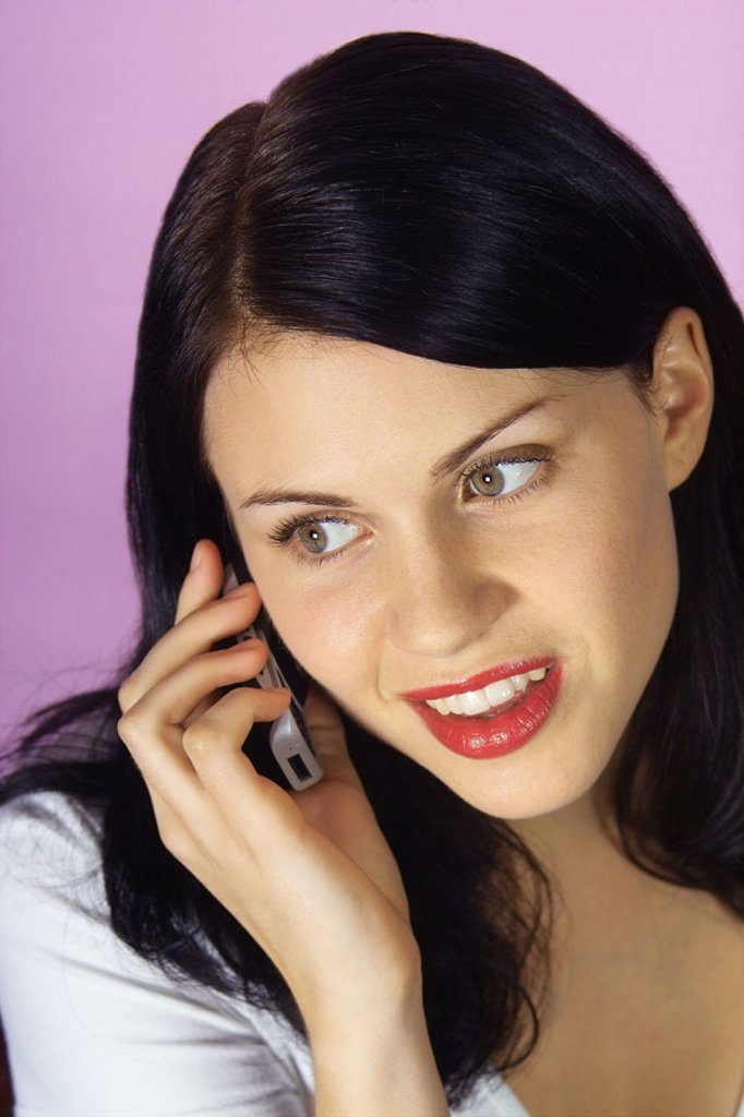 Stock Photo: 1558-62392 Woman, young, cell phone, telephones, portrait   Women portrait, teenagers, 18-20 years, 20-30 years, long-haired, dark-haired, attractively, nicely, made up, make-up, discreetly, been in the habit of, telephone, portable phone, telephone conversation, te
