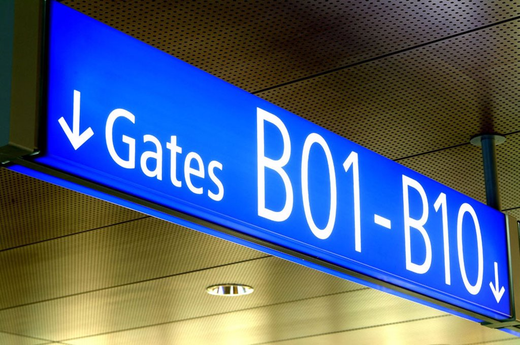 Stock Photo: 1558-63888 Transportation, traffic, airport,  Signposts, sign, Gates   Airport, trip, business, Travel, travel, flie, flight trip, information, information, bearings, goal, hint, takeoff, arrival, sign, detail, transit, blue, white, direction, terminal, Gate B01-B10