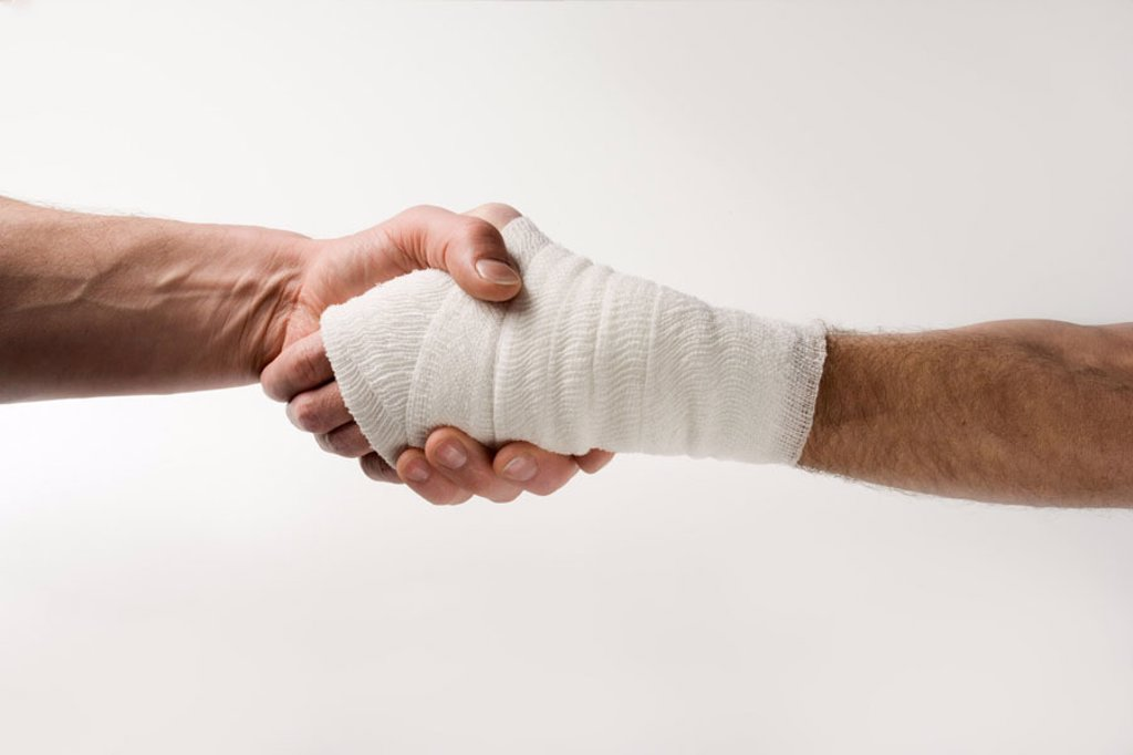Stock Photo: 1558-66799 Men, detail, handshake, hand,  Association  Illness, Männerhande, doctor, patient, contrast healthy sick, hurts, injury, wound, bandage, protective bandage, wound dressing, wound care, bound, connected, protection, pains, concept, emergency service, Hilfb
