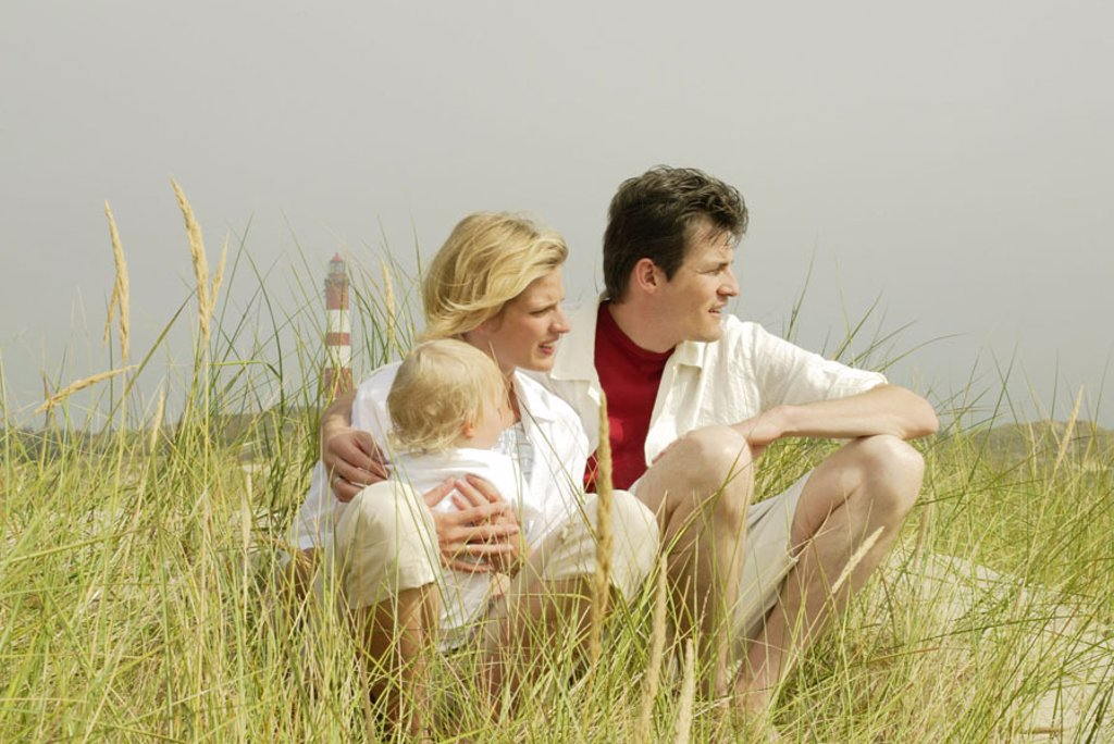 Germany, North sea island Amrum,  Dune landscape, family, relaxation, Background, lighthouse, Series, Schleswig-Holstein, North Frisian islands, island, dunes, grasses, parents, child, toddler, daughter, girls, sitting, recuperation, relaxen, enjoying, to : Stock Photo