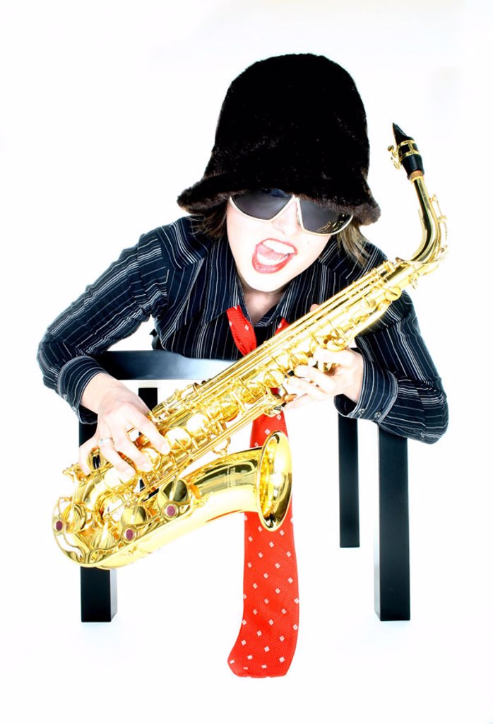 Stock Photo: 1558-69019 lie woman, young, facial expression, table,  Saxophone  Series, 20-30 years, musician, brunette, sun glass, sings hat, fur cap headgear necktie clothing clothing style, music, musically, instrument, concept, hang, flie, displaces, lifted off, cleverly, se