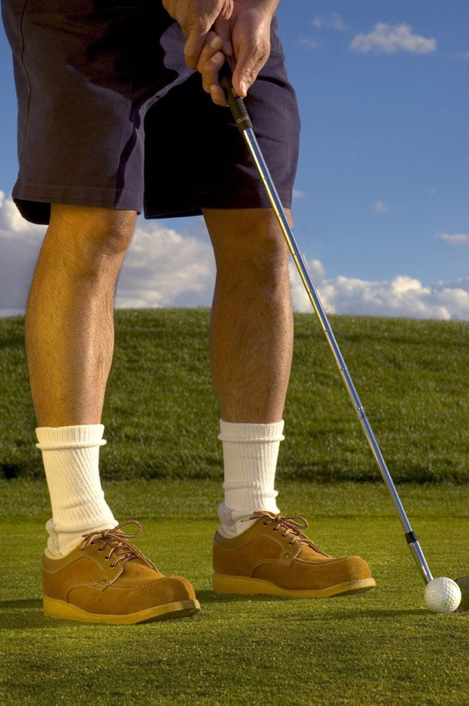 Stock Photo: 1558-71745 Golf course, golfers, detail, legs,,  Clubs, ball, reduction  Sport, lawn sport, man, golfers, athletes, golf clubs,,  aims, concentration, ball, golf, refuses to gulves,  Golf games, activity, golf lawns, lawns, lawn sport,  Sport, hobby, leisure time, c