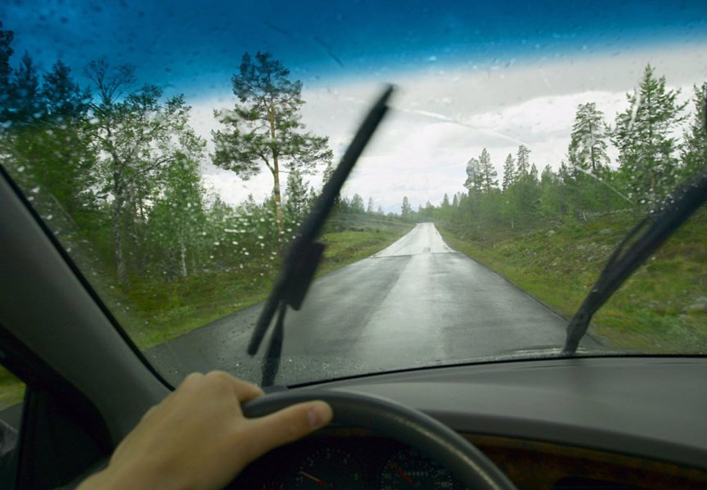 Private car, detail, driver area, steering wheel, hand,  Windscreen, windshield wipers,  Country road Look street, Autofahren, motorists, drives, concentration, rainy weather, rainy, roadway, wet, Norway, Engerdal, : Stock Photo