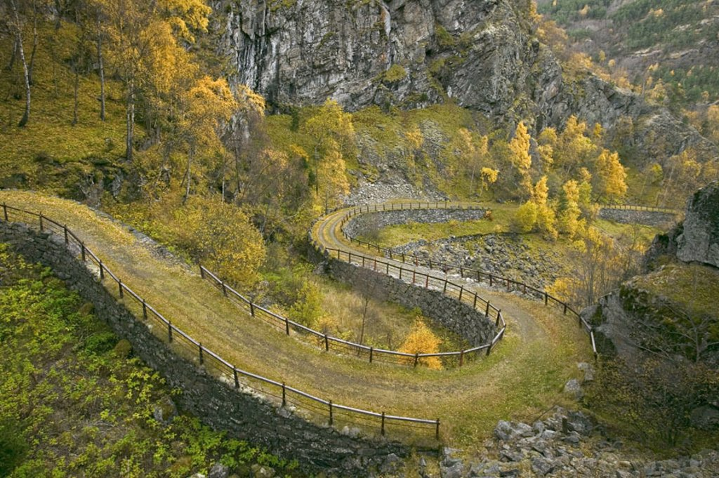 Norway, Sogn of og Fjordane, Leardal,  Vindhella, curves,  Europe, Scandinavia, west Norway, Lærdal, Vindhella-Straße, mountain street, mountain street, country road, curved, landscape, built 1793, rebuilding 1843, wound nature, trees autumnal : Stock Photo
