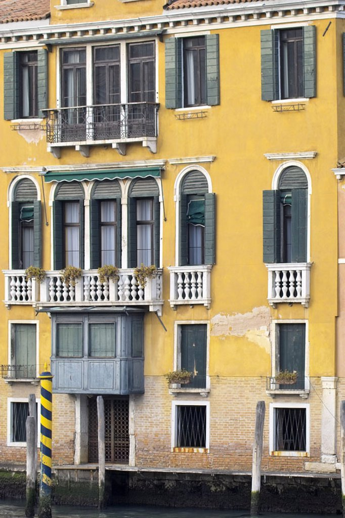 Italy, Venezien, Venice, residence, Facade, detail, Canal Grand,  Landing places Lagoon city, house, multilevel, house facade, yellow, weather, old, unkempt, waterway, connection, waters, wood posts, typical, Venetian, concept, destination, tourism : Stock Photo