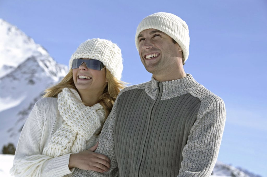 highland, couple, young,  Winter clothing, cheerfully, laughing, Half portrait, snow, winters Winter landscape, 20-30 years, caps, sun glass, friends, falls in love, happily, mood positively, leisure time, concept, partnership, friendship, love, pleasantr : Stock Photo