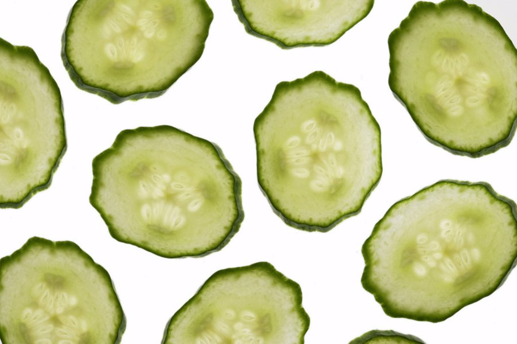 Stock Photo: 1558-76112 Cucumber, bragged, disks   Vegetables, cucumber, snake cucumber, homestead cucumber, Cucumis sativus, pumpkin plant, food, raw food, cut, cucumber disks, salad, fact reception, free plates,