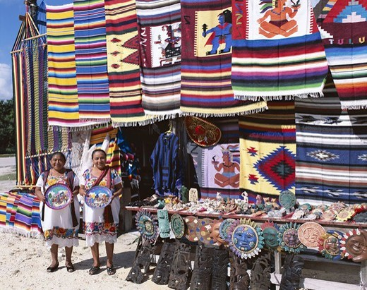 Mexico, Yucatan, Cancun, souvenir sale,  Women, clothing, traditionally, handicraft,  Mayakultur  Central America, economy, tourism, business, stand, outside, souvenirs sale souvenir stand, people, natives, sales associates, Mexicans, tradition, outfits, : Stock Photo