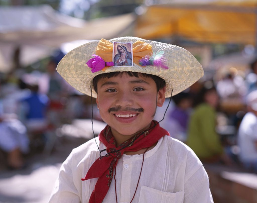 Mexico, Oaxaca, boy, disguise,  Straw hat, mustache, ´Mexicans´   Central America, people, natives, child, Mexican, tradition, outfit, folklore, headgear, hat, Sombrero, saint picture, culture, fun, party, event, childhood, : Stock Photo