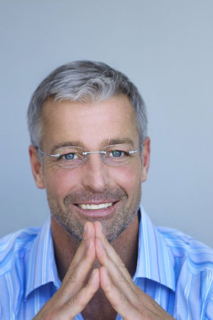 Man, middle age, glasses, smiling,  Touch, fingertips, portrait  Series, men´s portrait, 40-50 years, well Ager, grey-haired, short-haired, Dreitagebart, glasses bearers, good-looking, attractively, sympathetically, successfully, shirt, blue-striped, gaze : Stock Photo