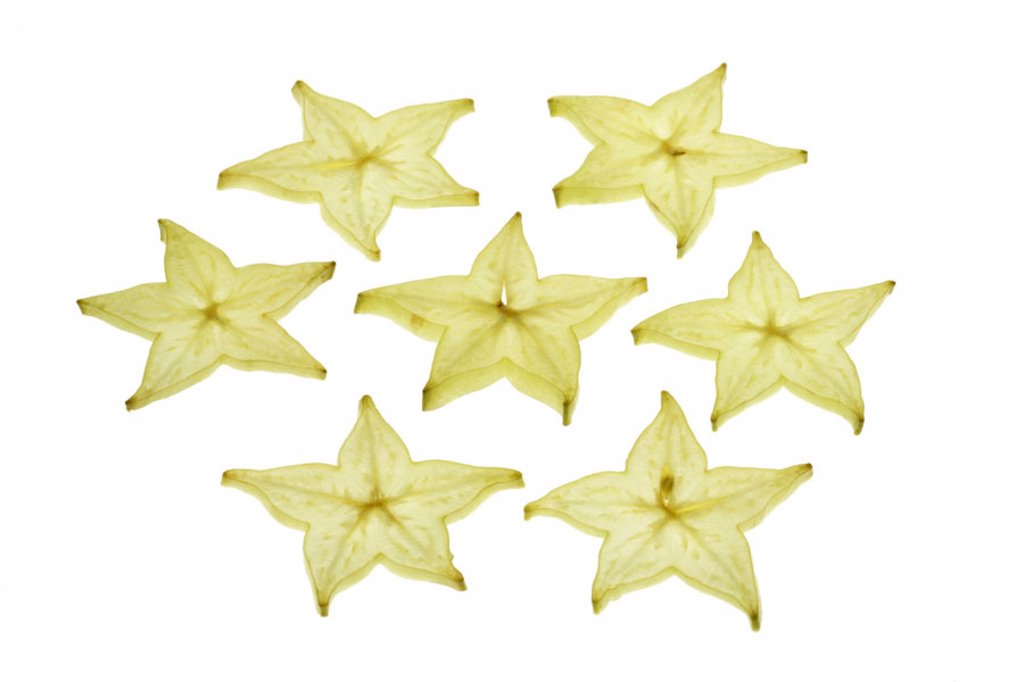Star fruit, disks,   Food, fruit, South fruit, exotic, tropical, Averrhoa carambola, nutrition healthy, rich in vitamins, vitamin-containing, vitamin C, cut, bragged, asteroid, stars, yellow, quietly life, studio free plates fact reception, : Stock Photo
