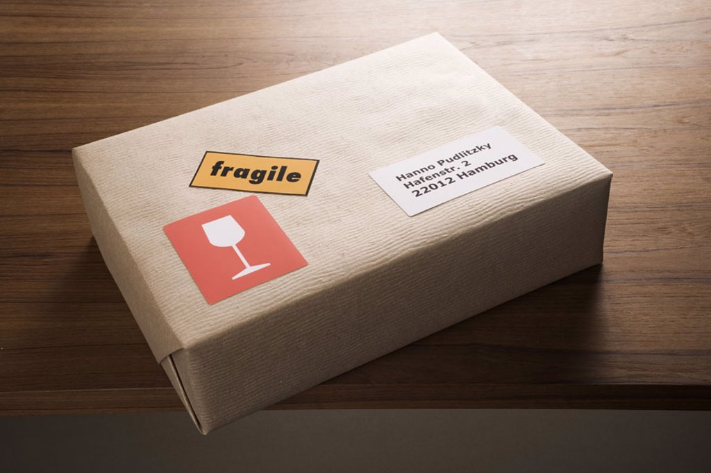 Stock Photo: 1558-82065 Package, address stickers, labeling,  ´fragile´, fragile   Series, mail, packet, carton, parcel, package, shipping, ware, program, packs, packing paper, sends, sends, stickers, label, Label, glass, address, address, recipients, hint, respect, caution, mai