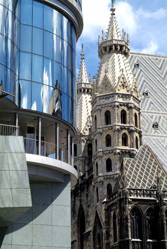 Stock Photo: 1558-82658 Austria, Vienna, Stephan place,  Haas house, facade, Stephansdom, Detail Capital, buildings, construction, Haas-Haus, entrance, at the beginning of area, architecture, style, modern, post-modern, Architect Hans Hollein little, glass facade, mirror facade,