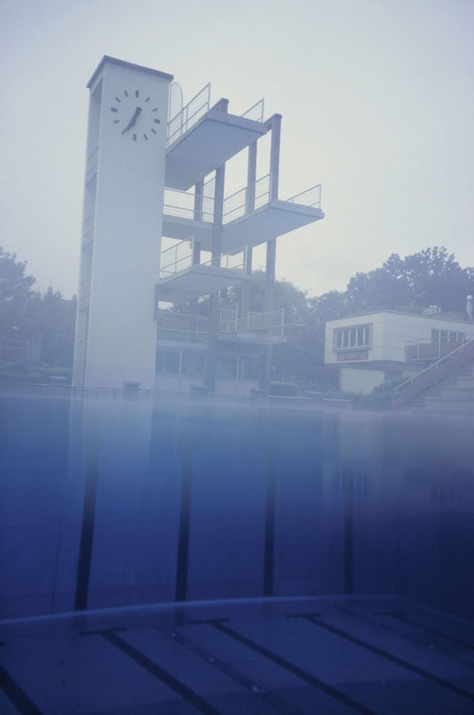 Stock Photo: 1558-84590 Pools, Sprungturm,  Clock, under water, over water,  Fuzziness Swimming pool, free bath, water, clouds outside, heaven, hazy, foggily, uncanny, empty, nobody, mood, tracks, marking, refraction