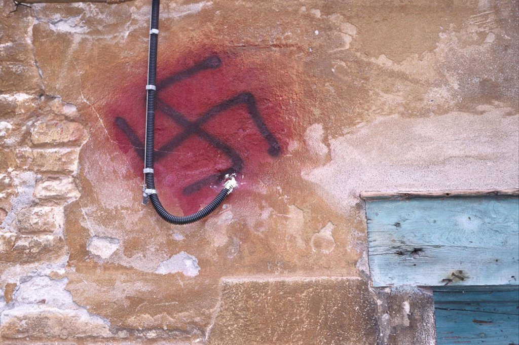 Stock Photo: 1558-85526 Facade, detail, swaretika signs,    Wall, wall, Graffitti, graffiti, swaretika, cross, corner measurement cross, belief, religion, politics, antisemitism,