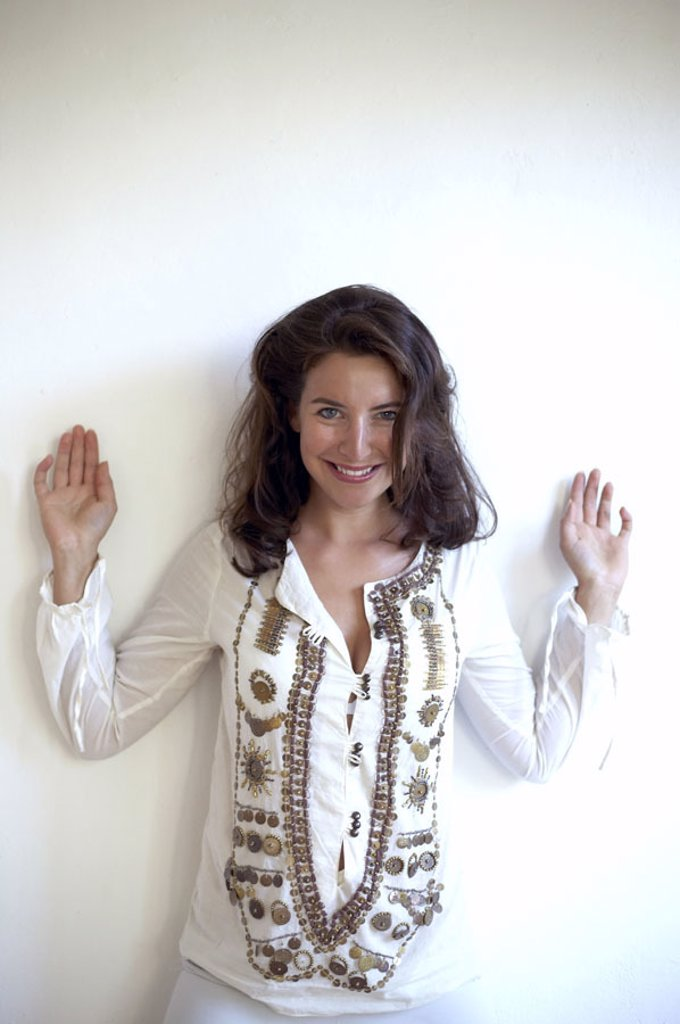 Stock Photo: 1558-88627 Woman, young, long-haired, blouse embroiders, Look camera, laughing, Halbporträt,   Series, 20-30 years, brown-haired, stand, poor lift, ´Hands high´, cheerfully, happily, mood positively, attractively, naturalness, Fashion, styling, Outfit, Look, youthfu