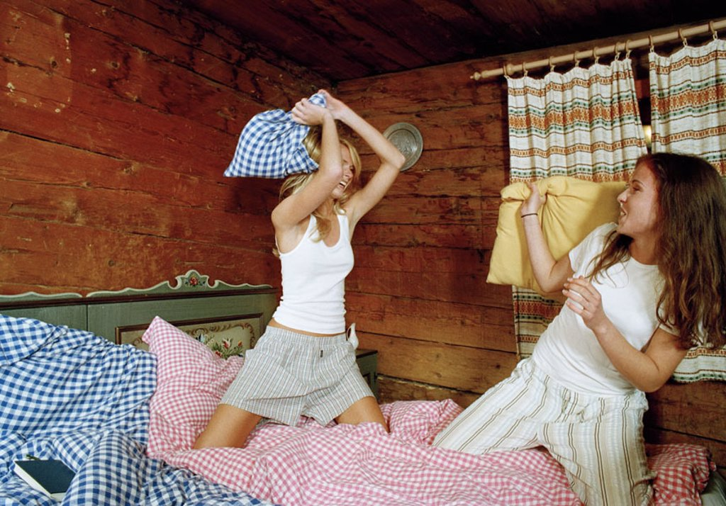 Almhütte, women, two, young, underwear,  Bed, fun, pillow battle, cheerfully, laughing,   Series, friends, 20-30 years, blond, dark-haired, Alm, cottage, dormitory, roost, pillows, checkered, rural, rustic, wood, coziness, heat, comfort, simply, simply, v : Stock Photo