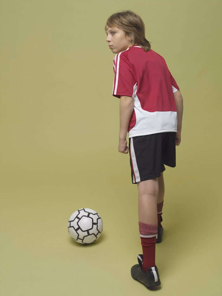 boy, soccer games, view from behind,  interior,   Series, 8-12 years, child, soccer players, sportswear, jersey, shorts, football shoes, ball, leather ball, football, ball sport, sport, ball game, hobby, leisure time, studio, concept, Fußball-WM, world ch : Stock Photo