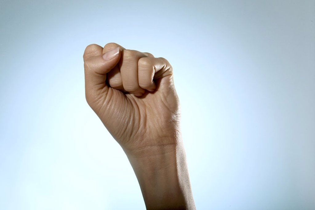 Stock Photo: 1558-91779 Women hand, fist,    Series, woman, young, detail, hand, skin, delicately, finely, been in the habit of, hand attitude, signals, concept, sign language, nonverbal communication, indicates, shows, displeased, displeasure, insult, dispute, conflict, threat,