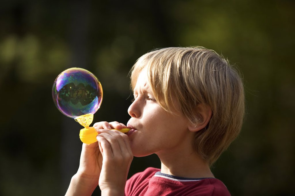 boy, bubble, profile,    Child, 11 years, blond, leisure time, vacation, enjoyments, playing freely, casual activity,  Naturalness, profile, outside, : Stock Photo