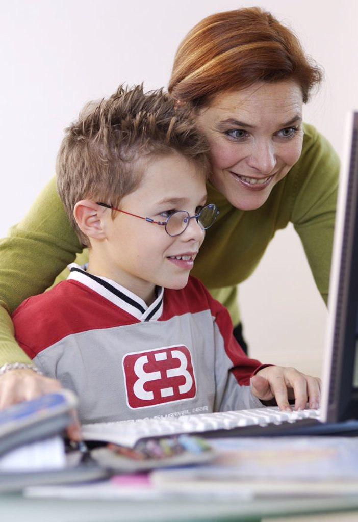Mother, boy, laptop, data input,  School records, laughing, cheerfully, detail,   Series, woman, child, students, schoolchild, 6-10 years, computers wearable, internet, Internetsurfen, shows, explains, learning, information, interest, homework, further ed : Stock Photo