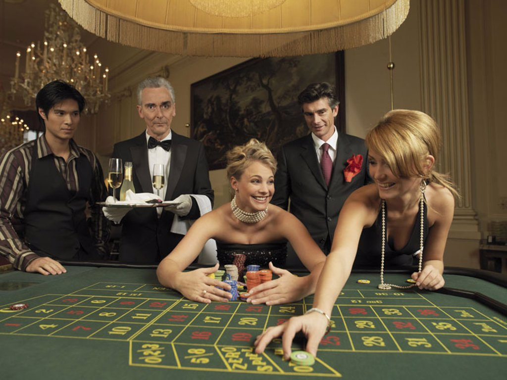 Stock Photo: 1558-98678 Casino, Roulette-Tisch, waiters,  Players, young, elegantly, happy, Jetons, places, Halbporträt,  Spielcasino, card table, game field, Tableau, gamble, game, roulette, employee, waiters, services, serves tray, champagne, guests, from women, evening cloakr