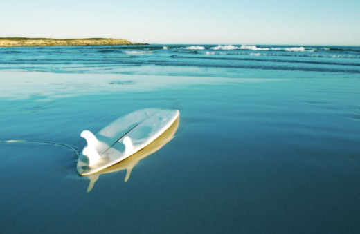 Surfboard floating on the water, Fishery Bay, Australia : Stock Photo