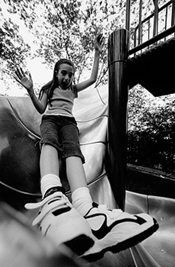 Girl sliding board. New York City. USA : Stock Photo